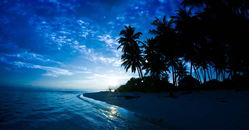 Take a romantic stroll for a sunset on a deserted beach in the Maldives